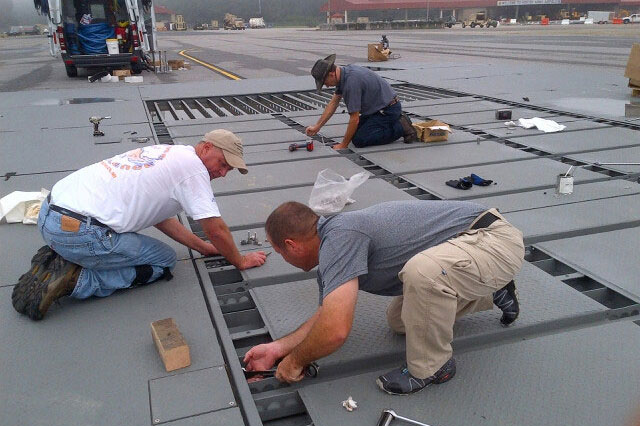 workers assembling wash rack