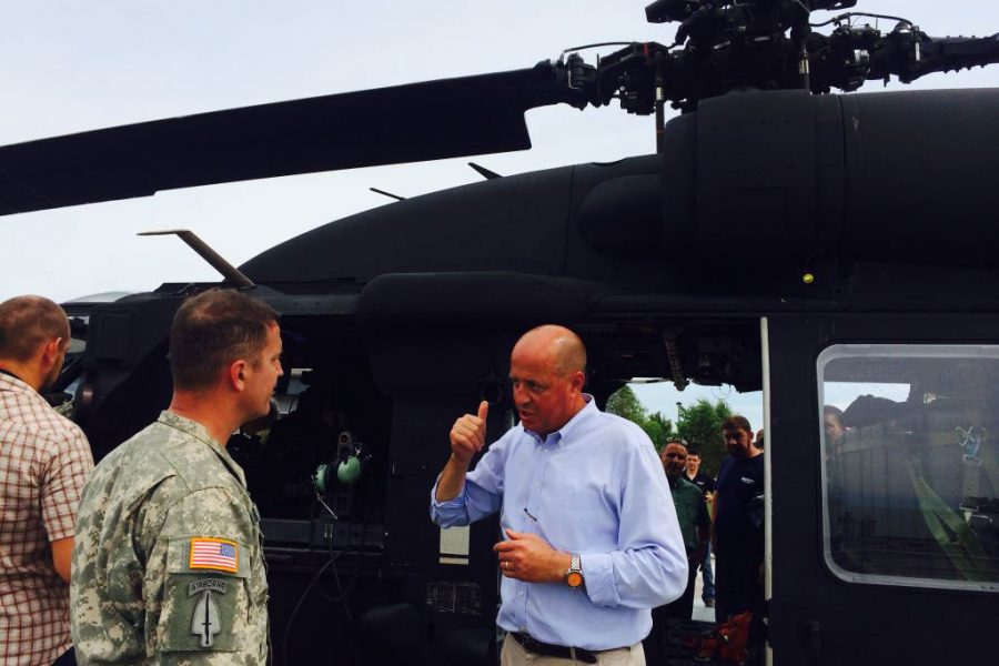 men talking by helicopter