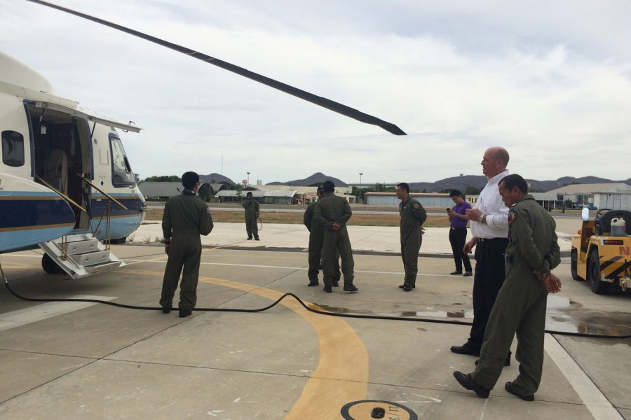 standing around helicopter
