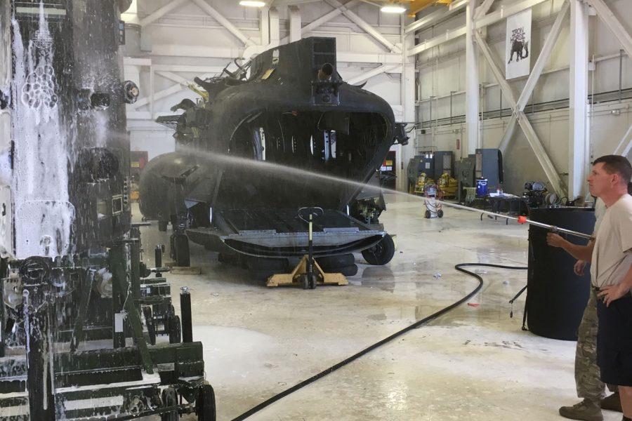 rinsing helicopter in hanger